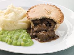Steak Pie Mash and Mushy Peas Stock Photos