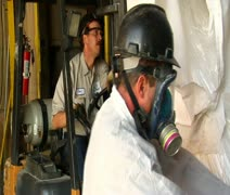 Forklift operator with worker move chemicals Stock Footage