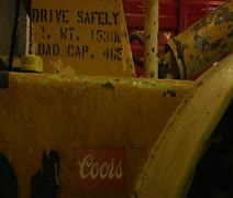Safety sign and Coors beer sign Stock Footage