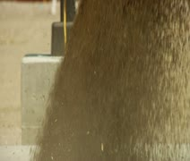 Close-up on grain pouring into metal grate Stock Footage