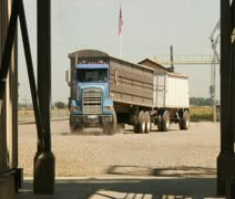 Semitruck in dirt parking lot with American flag Stock Footage