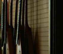 pan from stringed instruments to worker - stock footage