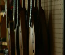 Shot of stringed instruments hanging on the wall Stock Footage