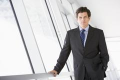 Businessman standing in corridor Stock Photos