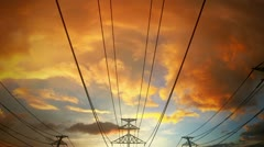 Electricity pylons and power lines industry metal construction wires sun and sky Stock Footage