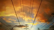 Stock Video Footage of Electricity pylons and power lines industry metal construction wires sun and sky