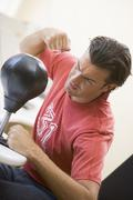 Man indoors using small punching bag Stock Photos
