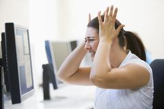 Woman in computer room looking frustrated Stock Photos