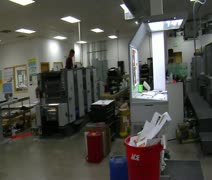 Wide panning shot of print shop Stock Footage