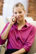 Businesswoman sitting in office space smiling Stock Photos