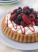 Whipped Cream and Berry Sponge Flan - stock photo