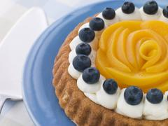 Whipped Cream Peach and Blueberry Sponge Flan - stock photo