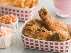 Southern Fried Chicken Coleslaw Baked Beans Fries and Strawberry Milkshake Stock Photos