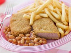 Breadcrumbed Luncheon Meat with Baked Beans and Chips Stock Photos
