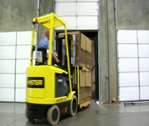 Forklift loads pallets onto semitruck trailer Stock Footage