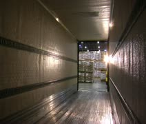View from within semitruck trailer as pallets are loaded by forklift Stock Footage