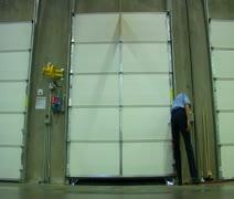 Man opens door to reveal cargo in semitruck trailer Stock Footage
