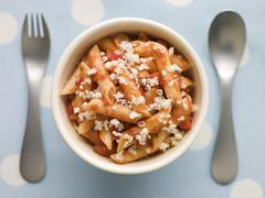 Penne Pasta Tomato Sauce and Grated Cheese Stock Photos