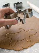 Cutting out a Gingerbread Man - stock photo