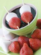 Strawberry and Marshmallow Sticks with Chocolate Sauce Stock Photos
