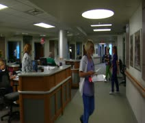 Gliding shot of busy nurses and hospital shot Stock Footage