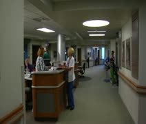Gliding shot of busy nurses and staff in hospital - stock footage