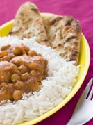 Chicken and Chickpea Curry with Rice and Naan Bread - stock photo