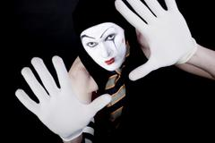portrait of mime in white gloves - stock photo