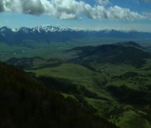 Aerial shot of Paradise Valley, Montana on blue-sky day Stock Footage