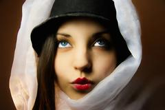 Woman in a hat and a kerchief Stock Photos