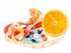 medicine and diet to lose weight - stock photo