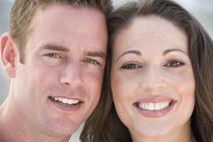 Couple outdoors smiling - stock photo