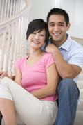 Couple sitting on staircase smiling Stock Photos