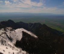 Gallatin Valley Montana - snowy peaks, green valley below Stock Footage