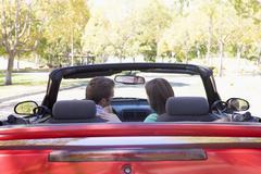 Couple in convertible car Stock Photos