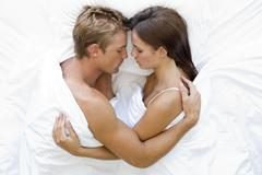 Couple lying in bed sleeping Stock Photos