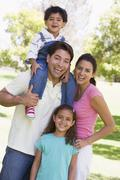 Family outdoors smiling - stock photo