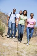 Two couples walking on path smiling Stock Photos