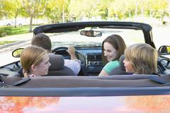 Family in convertible car smiling Stock Photos