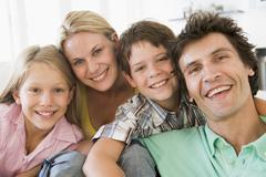 Family in living room smiling Stock Photos