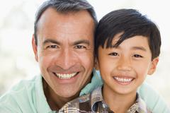Man and young boy smiling Stock Photos