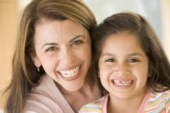 Woman and young girl smiling Stock Photos