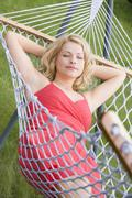 Woman sleeping in hammock Stock Photos