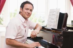 Man playing piano Stock Photos