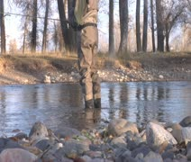 Waist down shot of fly fisherman standing in water Stock Footage