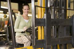 Warehouse worker in forklift Stock Photos