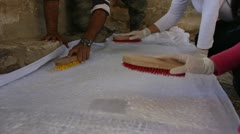 Pasting Cloth on Mosaic Surface Stock Footage