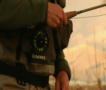 Tight shot of hand on flyfishing reel while casting Stock Footage