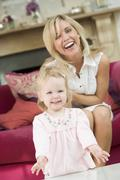 Mother in living room with baby smiling Stock Photos