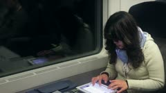 Businesswoman sending email on train Stock Footage
